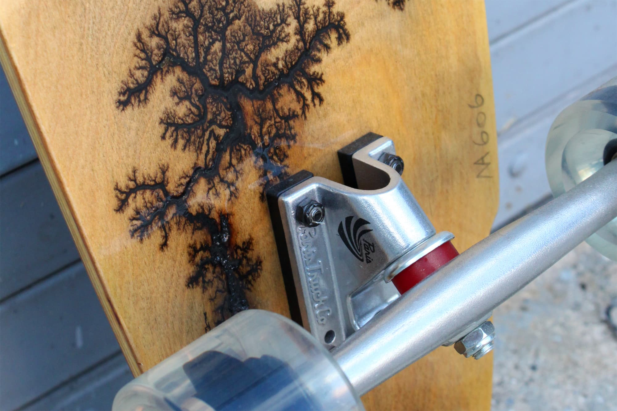 One-of-a-kind high voltage wood-burning deck art on every board